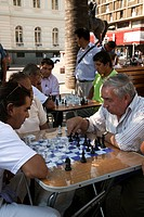South America, Chile, Santiago. Men playing chess in the Plaza de Armas. Credit: Wendy Kaveney / Jaynes Gallery / DanitaDelimont.com
