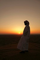 Arab Man watching the sunset