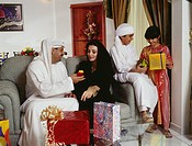 A happy family is seen in the house as they exchange gifts during the festival.
