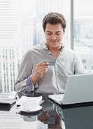 Businessman using credit card to shop on internet