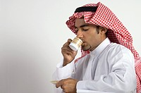 Young Arab man Drinking Coffee