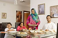 Arab Family looking at camera while dining