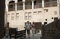 Couple visiting historical site, Dubai, United Arab Emirates
