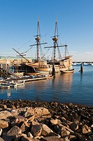 Mayflower II and other boats moored in Plymouth Harbor at dawn in Plymouth Massachusetts