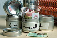 Money in containers, close_up