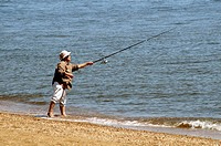 man fishing at the Sandy Point Beach in Maryland