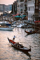 Gondola on the Grand Canal at sunset in Venice, Italy