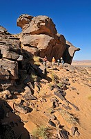 Group of tourists, people hiking on Tasset Plateau, Tassili n'Ajjer National Park, Unesco World Heritage Site, Wilaya Illizi, Algeria, Sahara, North A...