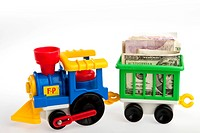 Toy train transporting bank notes