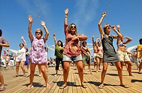 Women dancing on deck of cruise ship