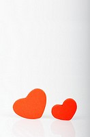 Stock photo red love hearts displayed on a white background
