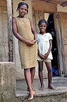 Mother and daughter in front of their simple wooden house, Petit Goave, Haiti, Caribbean, Central America