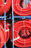 Red plastic tubing for construction