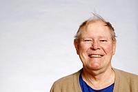 Elderly man with funny hairdo