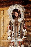 Young Athabascan woman modeling the traditional fur clothing of her native tribe, Chena Indian village, Alaska