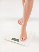 Woman on bathroom scale