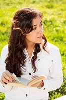 Young brunette in white with book