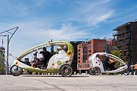 Bicycle taxis in front of modern architecture in the Hafencity district, Hamburg, Germany, Europe