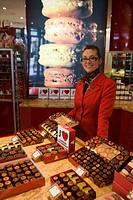 Smiling shop assistant at Les Caneles Baillardran bakery and cake shop, Bordeaux, Gironde, Aquitane, France, Europe