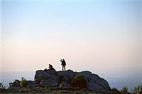 People on Feldberg at Taunus mountains at sunset, Hesse, Germany, Europe
