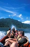 Tourists in a boat on lake Kao Laem, Sankhlaburi, Kanchanaburi, Thailand, Asia
