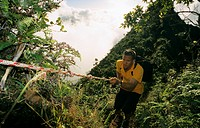 Aorai, Man climbing up Mount Aorai, Tahiti, Windward Islands, French Polynesia, South Pacific
