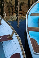 Rowboats with reflection of a dock