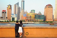 Pudong skyline and people at the river bank, Shanghai, China, Asia