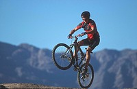Mountainbiker in front of Anti_Atlas mountains, Tafraout, Morocco, Africa