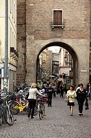 Pedestrians walking through Porta Altinate in Padua, Veneto, Italy