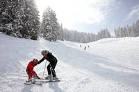 Mother and daughter near slope, skiing area Heuberg, Heubergmuldenlift, Hirschegg, Kleinwalsertal, Vorarlberg, Austria