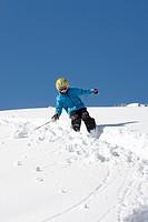 Child skiing in deep snow, Schlosslelift, Hirschegg, Kleinwalsertal, Vorarlberg, Austria