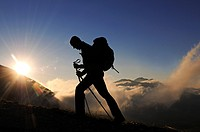 Hiker at Corno Grande at sunrise, Campo Imperatore, Gran Sasso National Park, Abruzzi, Italy, Europe