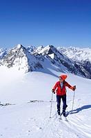 Female backcountry skier ascending to hut Zittelhaus, Hoher Sonnblick, Rauris valley, Goldberg mountain range, Hohe Tauern, Salzburg, Austria