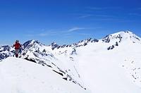 Woman ascending mountain Im Hinteren Eis, Weisskugel in background, Schnals valley, Oetztal Alps, Vinschgau, Trentino_Alto Adige/Suedtirol, Italy
