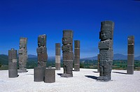 Sculptures under blue sky, Atlases on pyramid B, Tula, Hidalgo, Mexico, America