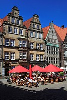Historical houses and sidewalk cafes at the market square under blue sky, Hanseatic City of Bremen, Germany, Europe