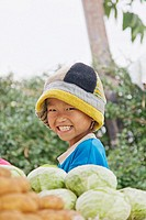 Portrait of a smiling boy in a market in Pai, Nord Thailand