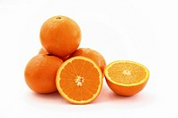 A stack of oranges with one orange sliced in two