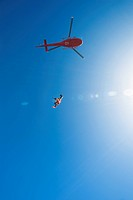 Skydiver jumping from helicopter