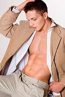 attractive man in beige jacket
