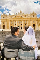 Portrait of bride and groom kissing n front of Saint Peter´s square Vatican Rome Italy