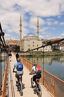 Mountainbiker on the bridge in the front of a mosque, Avanos, Cappadocia, Turkey, Goereme, Cappadocia, Turkey