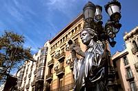 Street artist in front of street lamp, La Rambla, Barcelona, Spain, Europe