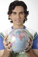 Teenage boy standing with globe in both hand MR 687T