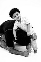 South Asian Indian boy playing with his father , India MR727A
