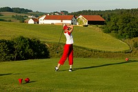 Female golfer on a golf course, Pleiskirchen, Altoetting, Upper Bavaria, Bavaria, Germany, Europe