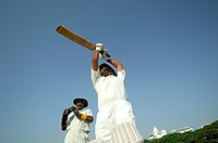 Indian right handed batsman in action playing lofted shot in cricket match MR705L