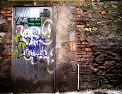 Derelict door with graffiti