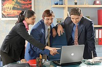 South Asian Indian businessmen and woman looking at laptop and conversation to each other in his office MR 670D , 670F ,670G